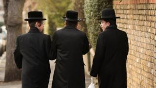 Jewish boys walking down street
