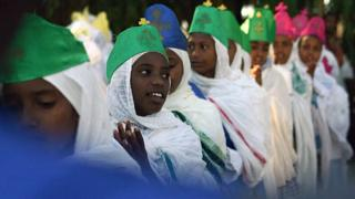 Eritrean youth are seen 19 January 2006 in Asmara during a colourful epihany festival in Eritrea. The festival, also known as 'Timkat' in the local Tigrinya language, is a commemoration of the baptism of The Christ observed annually among the Orthodox Christians