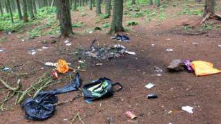 Rubbish and fire damage at an abandoned campsite near Bonaly Reservoir in the Pentlands