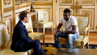 French President Emmanuel Macron (L) meets with Mamoudou Gassama, 22, from Mali, at the Elysee Palace in Paris, France, May 28, 2018.