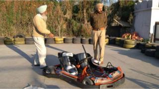 Police inspecting the go-kart in the amusement park in Haryana
