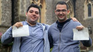 Syrian refugees Sulaiman Wihba (left) and Elias Badin after collecting their A-level results at Brighton College