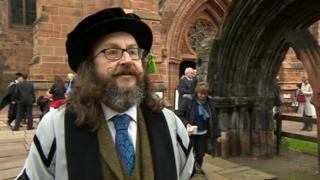 Dave Myers, wearing his cap and gown, at Cumbria Cathedral