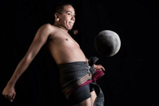 Ricardo Campos, a player of the pre-Columbian ballgame Ulama, hits a solid rubber ball with his hip