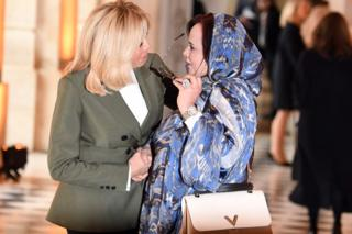 French first lady Brigitte Macron (L) greets her Mauritanian counterpart Tekber Mint Melainine Ould Ahmed at Versailles Palace, France - Sunday 11 November 2018