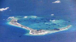 A still image from a US Navy video purportedly shows Chinese dredging vessels in the waters around Mischief Reef in the disputed Spratly Islands in the South China Sea