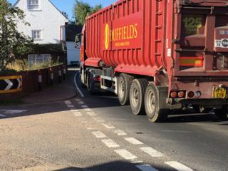 HGV lorry driving through village on single carriageway of A12