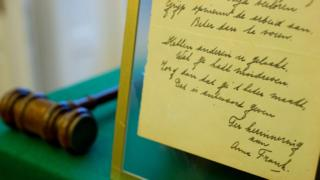 Anne Frank's 1942 handwritten poem and an auctioneer's hammer