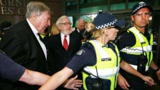 Cardinal George Pell and his lawyer were given a police guard entering court