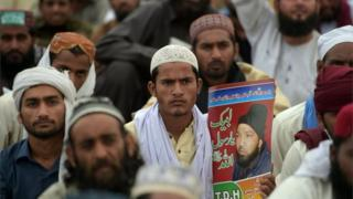 Supporters of executed Islamist Mumtaz Qadri sit-in during an anti-government protest in front of the parliament building in Islamabad on March 28, 2016.