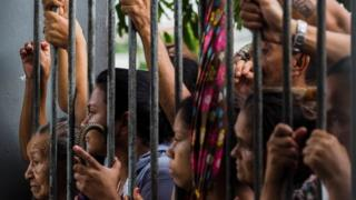 Relatives wait for information following a riot that ended with at least four prisoners killed inside Desembargador Raimundo Vidal Pessoa Public Jail, on January 8, 2017, in Manaus, Amazonas, Brazil.