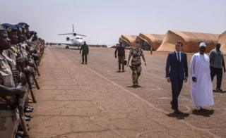 On Friday, French President Emmanuel Macron and his Mali counterpart President Ibrahim Boubacar Keita inspect a guard of honour during a visit in Gao, northern Mali