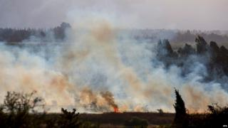 A fire near Kfar Sold, north of Israel, caused by four missiles fired from the Syrian side of the Israeli-Syrian border hitting open areas in the Golan Heights and Galilee, on 20 August 2015.