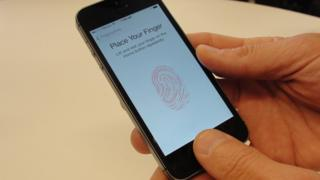 Apple's Touch ID system being demonstrated on iPhone