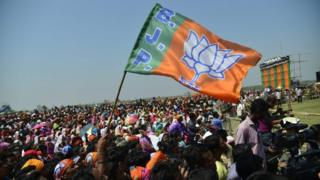 Bharatiya Janata Party (BJP) supporters listen to the Indian Prime Minister Narendra Modi (unseen) as he addresses an election campaign rally ahead of the second phase of Assam Assembly election in Nagaon district of Assam, India, 08 April 2016.