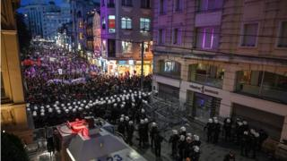 Turkish anti riot police officers block the street as demonstrators gather on Istiklal avenue in Istanbul