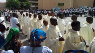Catholics dey match for street