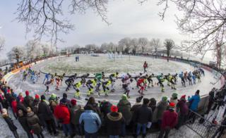 Ice skaters compete in the women's platoon during the first ice skating marathon on natural ice in Noordlaren, the Netherlands
