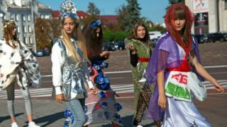 Participants of a fashion show wear outfits made out of garbage for World Cleanup Day in Chernihiv, northern Ukraine