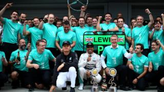 Lewis Hamilton with his Mercedes team