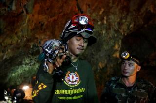 Soldiers and rescue workers work in Tham Luang cave complex