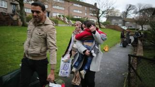Picture of Syrian refugees arriving in the Isle of Bute, Scotland