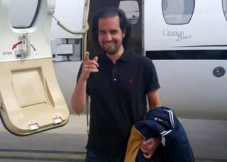 A handout picture released by the Inter Services Public Relations of Pakistan (ISPR) on 9 March 2016 show Shahbaz Taseer, son of slain Punjab governor Salman Taseer, gesturing before boarding a chartered plane in Quetta on his way to Lahore, Pakistan, 9 March 2016.