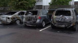 Burned cars are seen in a row in Gothenburg, Sweden