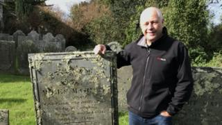 Barry West with headstone