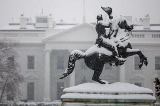 Statue of Andrew Jackson covered in snow