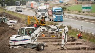 Diggers working on the foundations of the Calais wall