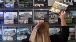 First-time buyer at estate agency