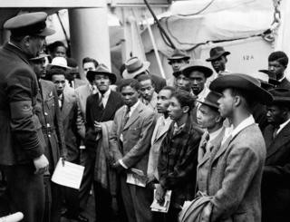 RAF officials from the Colonial Office welcomed Jamaican immigrants when HMT 'Empire Windrush' landed at Tilbury.