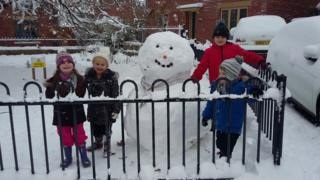 Four children with snowman