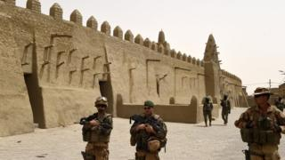 Soldiers patrol next to the Djingareyber Mosque in Timbuktu, Mali - June 2015