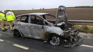 Burnt car on A34