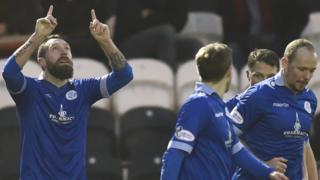 Stephen Dobbie celebrates scoring his 17th goal of the season