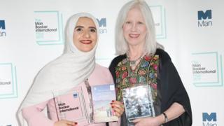 Arabic author Jokha Alharthi (L) and translator Marilyn Booth after winning the Man Booker International Heavenly Body award in London on 21 May 2019
