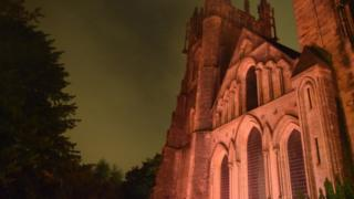 Llandaff Cathedral lit up in red light