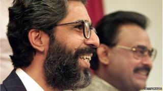Pakistani Muttahida Quami Movement (MQM) Secretary-General Imran Farooq (L) laughs with party founder Altaf Hussain (R) during their press conference in London in September, 1999