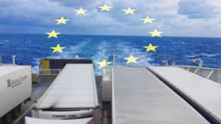 Lorries parked on deck of a Stena Line ferry to Dublin from Holyhead, with an EU flag imposed in the background