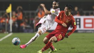 Alaa Al Shbbli of Syria and Zhang Xizhe of China in action.