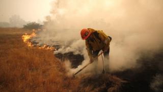 California firefighter tackles blaze