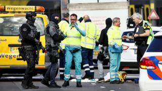 Police forces and emergency services stand at the scene of a terror attack on a tram Utrecht in March 2019
