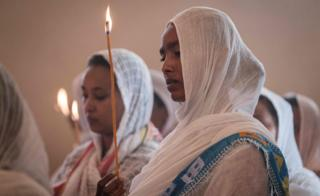 Devotees hold candles during a special service for the families of the victims of the crashed Ethiopia Airlines at Ethiopian Orthodox Church in Nairobi, Kenya, on March 17, 2019