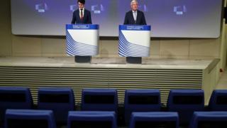 EU Brexit negotiator Michel Barnier, right, speaks following the third round of Brexit talks