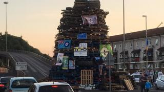 The bonfire is blocking the bottom of the Lecky Road