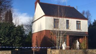 Police outside Pat Davidson's house after she fell from an upstairs window
