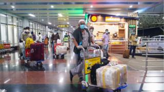 Evacuees from Dubai arrive at the Calicut airport in Kerala