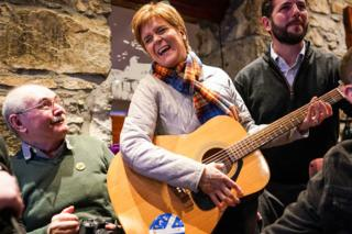 in_pictures Nicola Sturgeon strums a guitar